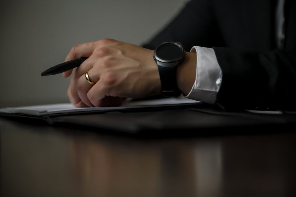hands of a lawyer holding a pen