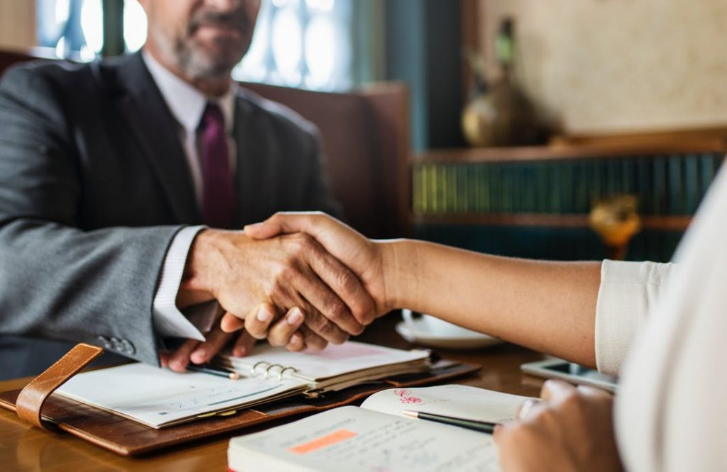 lawyer-client handshaking